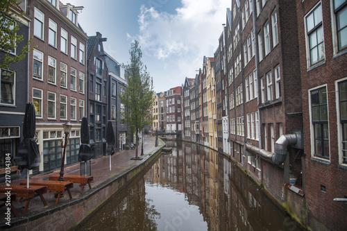Staande foto Amsterdam Traditional old buildings in Amsterdam