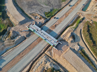 Aerial view on building site of road bridge for city road bypass