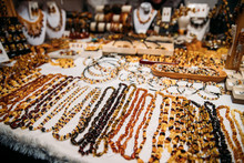 Amber Beads. Jewellery Made Of Amber. Traditional Souvenirs At European Market.