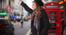 Attractive Caucasian Female Calling For Taxi Cab In London Street