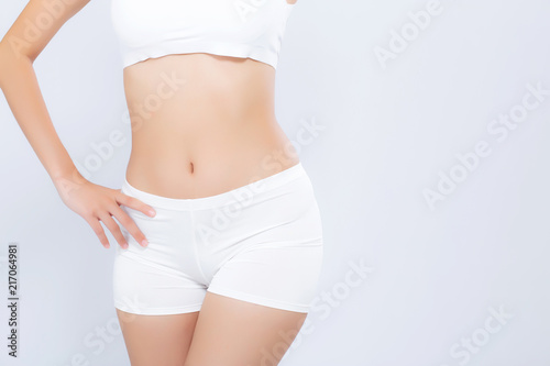 Closeup asian woman beautiful body diet with fit isolated on white background, model girl weight slim with cellulite or calories, health and wellness concept Obraz na płótnie