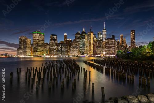 Canvas Prints New York City / USA - JUL 20 2018: Lower Manhattan skyline view from Brooklyn Bridge Park waterfront at sunset