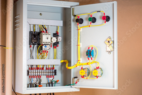 electrical terminal box  control panel with magnetic contactor and overload  relay  checking cartridge fuse on main distribution board
