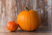 Vegetables, Harvest And Thanksgiving Concept - Ripe Pumpkin And Red Kuri Squash On Wooden Background
