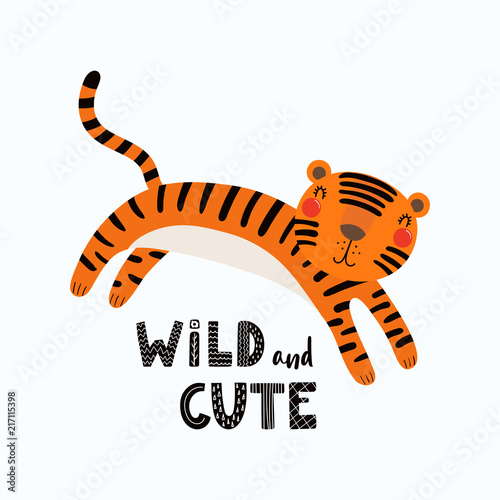 Photo Stands Illustrations Hand drawn vector illustration of a cute funny tiger, with lettering quote Wild and cute. Isolated objects on white background. Scandinavian style flat design. Concept for children print.