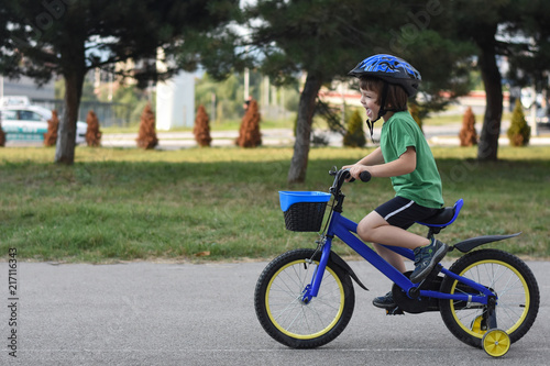 Five years old boy rides a bicycle in the city  Child riding bicycle