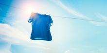Blue T-shirt On Clothes Line A...