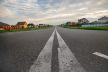 Asphalt Road In A Beautiful Modern Area. Road View From Below. Way Home. Highway To The City