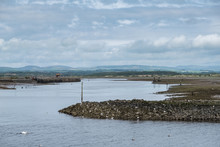 Old Crane Works & Wind Turbines From Irvine Harbour In Scotland.