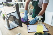 Cropped Shot Of Professional Cleaner In Rubber Gloves Cleaning Computer Keyboard In Office