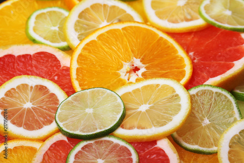 Photo Stands Slices of fruit Mix of citrus fruits cut in slices
