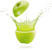 Fresh Juice Splashing Out Of A Green Apple Isolated On White Background