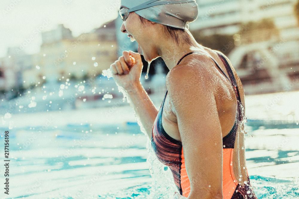 Fototapety, obrazy: Female swimmer celebrating victory