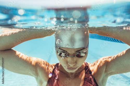 Woman swimmer inside swimming pool