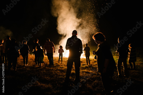 Group of people around a large bonfire
