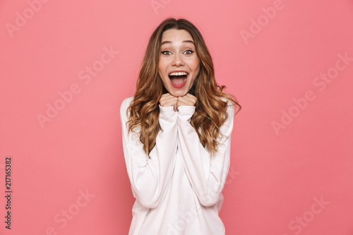 Portrait of an excited young casual girl screaming Canvas Print