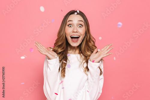 Obraz Portrait of a joyful young woman celebrating - fototapety do salonu