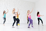 Group of happy young women having a fitness dance class