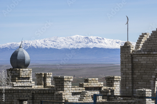 Canvas Prints Cemetery Kazakhstan, Muslim cemetery with Mountains in background