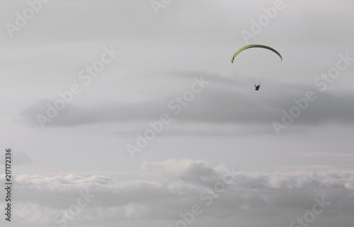 Foto op Canvas Luchtsport Paragliding in Serra do Larouco, Montalegre at Sunset, Silver Cloudy Sky.