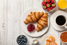 Breakfast With Croissants, Coffee, Jams And Berries