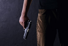Killer With Gun Close Up On A ...