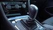 A man moves a gearshift to sport mode in a car - closeup