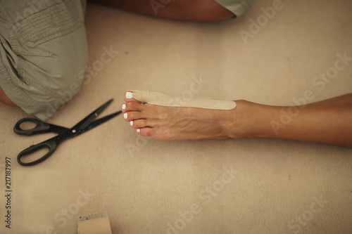 Tuinposter Gymnastiek Leg of gymnast with joint support kinesio tape for injury prevention