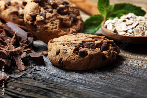 Keuken foto achterwand Koekjes Chocolate cookies on rustic table. Chocolate chip cookies and cookies with oat flakes or oatmeal.