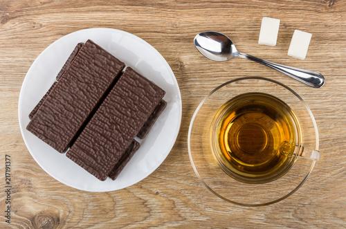 Papiers peints Pays d Afrique Wafer in chocolate, tea on saucer, sugar, teaspoon on table