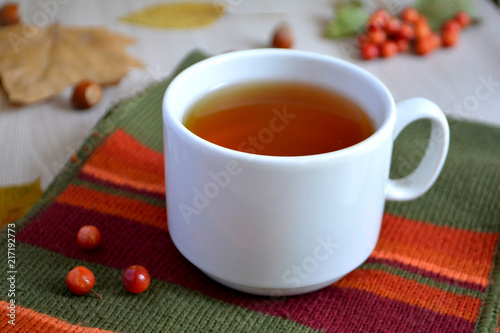 Staande foto Thee A cup of hot tea on a wool blanket. Autumn or winter warming drink. Autumn concept