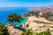 Sea skyview landscape photo Tsambika bay on Rhodes island, Dodecanese, Greece. Panorama with nice sand beach and clear blue water. Tsampika is a famous tourist destination in South Europe