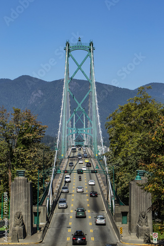 фотография lions gate bridge front view from stanley park on a sunny summer day