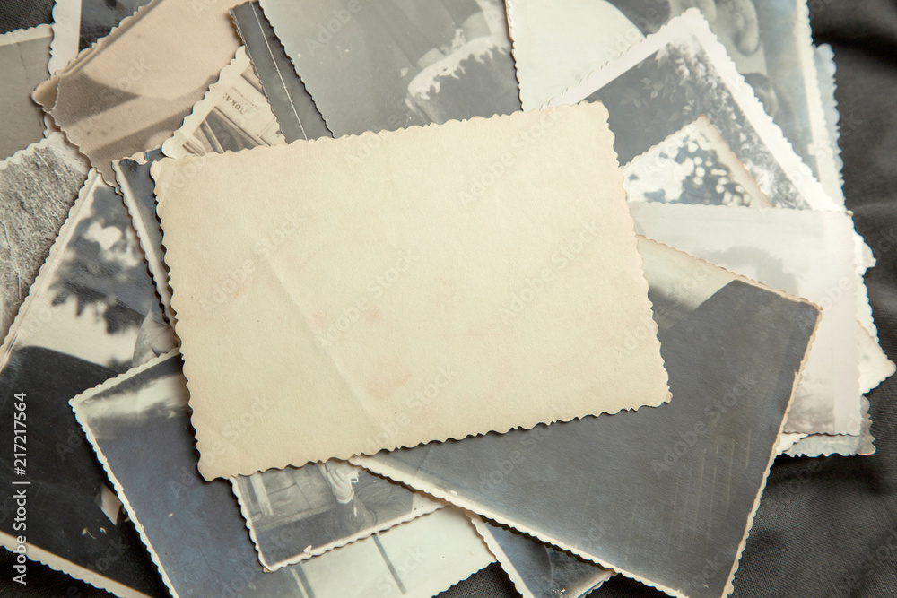 Fototapety, obrazy: Stack old photos on table. Mock-up blank paper. Postcard rumpled and dirty vintage