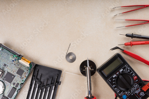 Foto op Aluminium Retro Multimeter, soldering tool and hand tools for electronics assembly. Copy space.