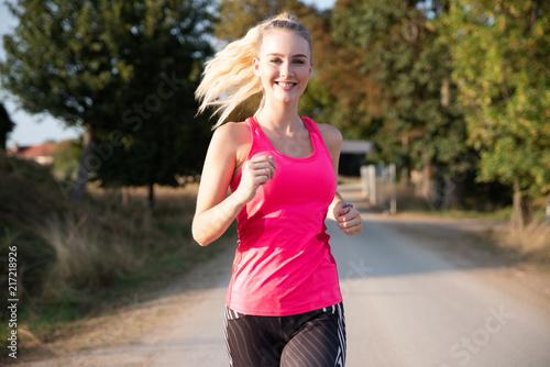 Poster Jogging Junge Frau beim Joggen