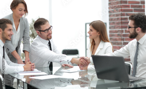 Fototapety, obrazy: handshake colleagues at a working meeting