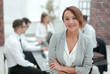 portrait of young business woman on blurred office background