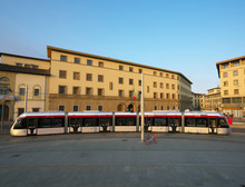 Florence,Italy-July 26,2018: A Tram Passes Near Firenze Santa Maria Novella Station, Florence, Italy, Just After The Sunrise