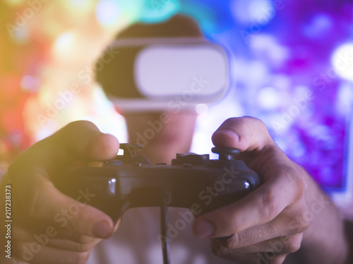 portrait of happy young man with virtual reality glasses and