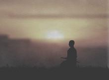 Japanese Swordsman Sitting In Meditation Under The Sunset