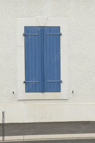 Foto op Aluminium Havana Closed blue wooden blinds on a white wall