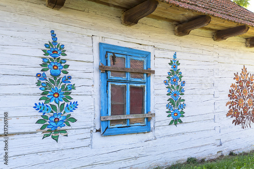 Painted old wooden cottage decorated with a hand painted colorful floral motives Fotobehang