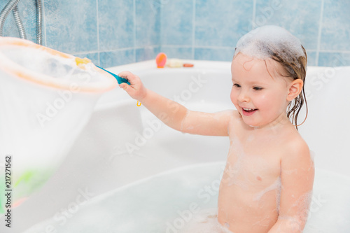 little girl have fun in the bath with nettle #217271562