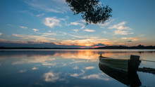 Art Tone,soft Focus And Silhouette A Boat On The Lake With Sundown Time Background