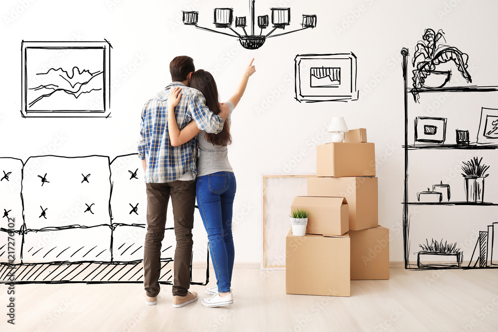 Fototapeta Young couple imagining interior of new house. Moving day