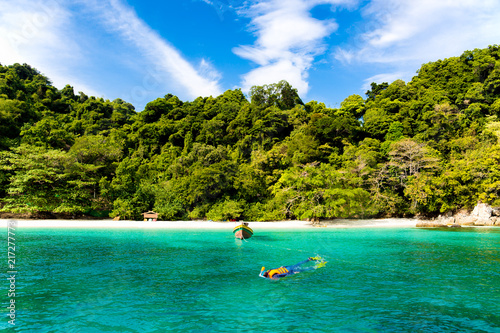 Photo Stands Water Motor sports Tourist woman snorkeling in tropical island in Thailand.