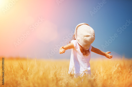 Happy Girl Walking In Golden Wheat Enjoying The Life In The Field Nature Beauty Blue Sky And Field Of Wheat Family Outdoor Lifestyle Freedom Concept Cute Little Girl In Summer Field