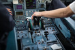Pilot's hand accelerating on the throttle in a commercial airliner airplane flight cockpit during takeoff