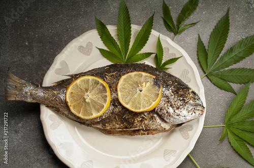 Fototapeta pieczona ryba z ziołami i cytryną obraz